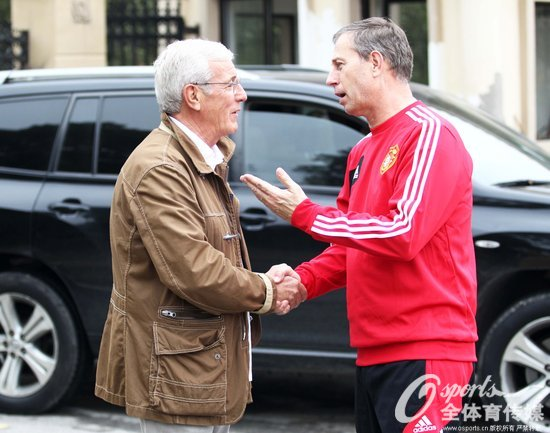 里皮与国足主教练阿兰·佩兰