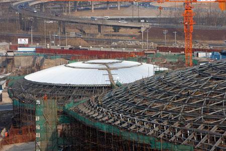 在以前的穹顶结构建筑中,连接环索的都是单根径向索.